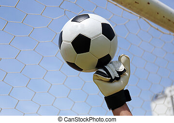 goalkeeper's hands hitting foot ball - goalkeeper's hands...