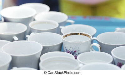 Distribution tea - Set of cups with tea distribute children