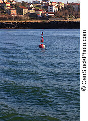light buoy in the blue sea