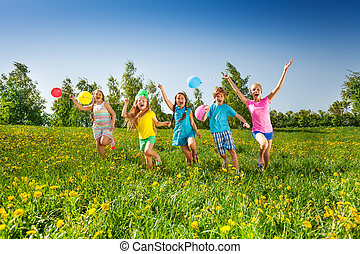 Happy five children with balloons run in field - Happy...