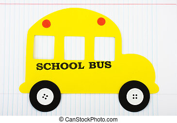 School Days - A yellow school bus sitting on a paper...