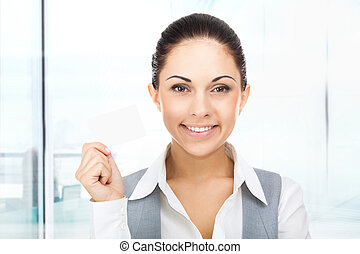 Businesswoman smile hold blank business card, young...