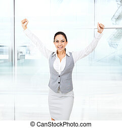 Business woman excited hold hands up raised arms, surprised...