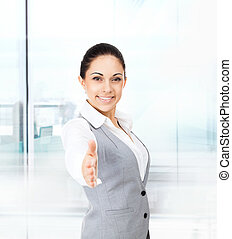 businesswoman handshake in modern office - businesswoman...