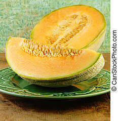 Sliced Cantaloupe on a Wooden Table - Sliced Cantaloupe on a...