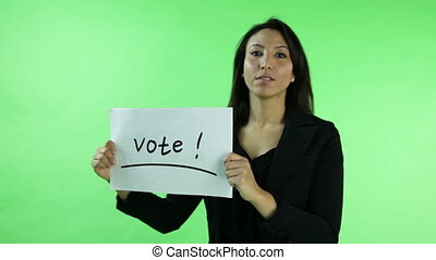 business woman isolated on green screen with election sign -...