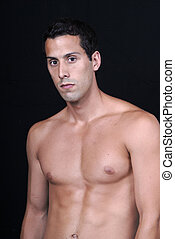naked muscular male model isolated on black