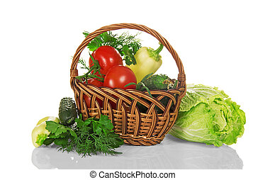 Basket with vegetables, pepper and cucumber - Basket with...