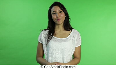 Casual woman isolated green screen presenting