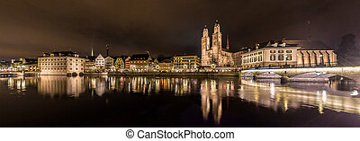 Zurich on banks of Limmat river at winter evening