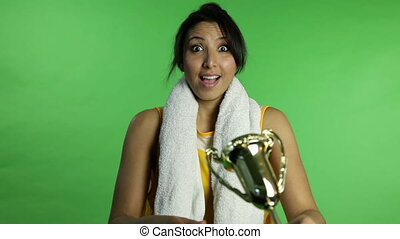 Sport woman isolated green screen receiving trophy