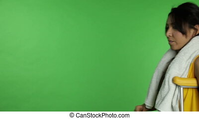 Sport woman isolated green screen confident with crutch -...