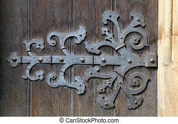 Decorative door hinge - Decorative metal hinge on an old...