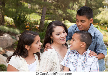 Happy Mother and Children in the Park