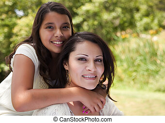 Mother and Daughter in the Park - Happy Hispanic Mother and...