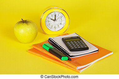 Exercise books, notepad, the calculator and apple