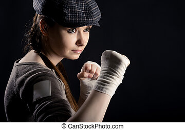 girl with a fighting stance - On a black background girl...