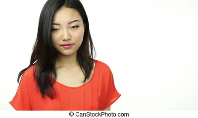 asian girl orange sundress isolated on white with vote sign...