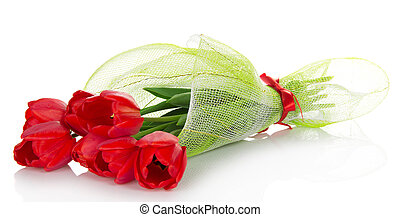 The bouquet of red tulips is decorated with a gossamer and a...