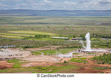 Geyser - Detailed view of Geyser and tourists in Iceland