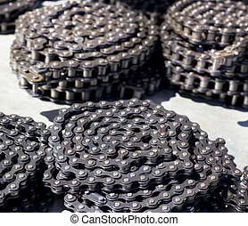 Motor chains - Rolls of motor chains arranged one next to...