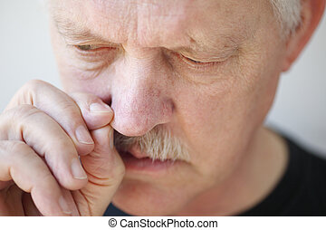 Man with stuffy nose pulls nostril - older man tries to...