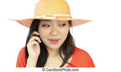 asian girl orange sundress isolated on white angry with phone call