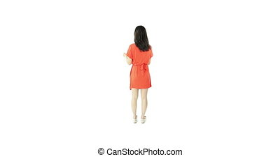 asian girl orange sundress isolated on white with help sign...