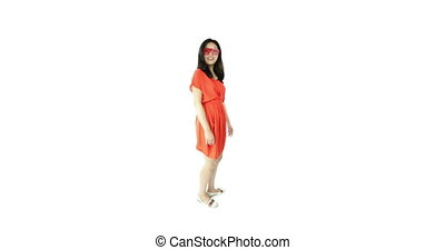 asian girl orange sundress isolated on white dancing...