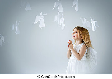 Cute girl - Little girl with wings in the studio