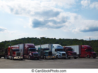 "Row of Parked Trucks at Truck Stop - Six ""big rig"" tractor..."