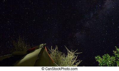Star timelapse against tent - Wide view of top of tent and...