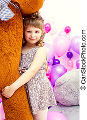 Happy little girl posing hugging big teddy bear - Image of...