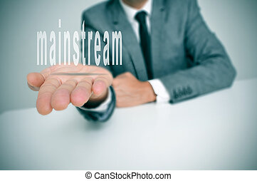 mainstream - man wearing a suit sitting in a desk holding...