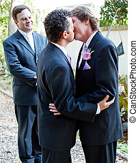 The Wedding Kiss - Two grooms kiss eachother in front of the...