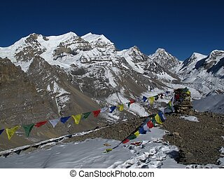 Prayer Flags and Purbung Himal, Annapurna Conservation Area,...