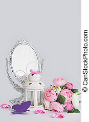 White decoration of cage, lantern and silver mirror