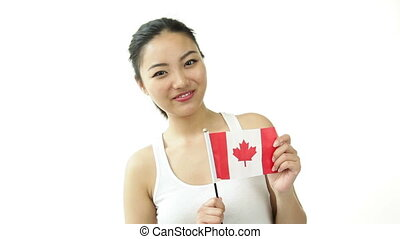 sport girl isolated on white with canadian flag - asian 20...