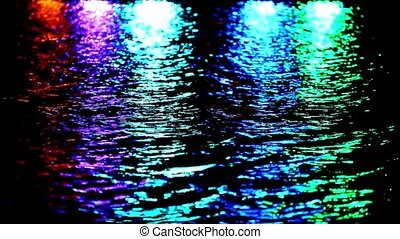 Colorful light reflect on the water at night. Video shift motion