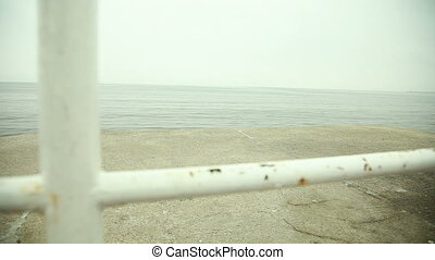 View from old pier on calm sea. - Landscape. View from old...