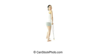 sport girl isolated on white smiling with crutch