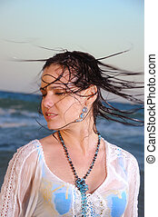 Wet hair - Portrait of young woman waving wet hair on the...