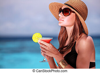 Drink cocktail on the beach - Portrait of stunning woman...