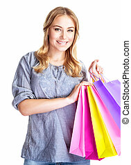Happy shopper girl with four colourful paper bags isolated...