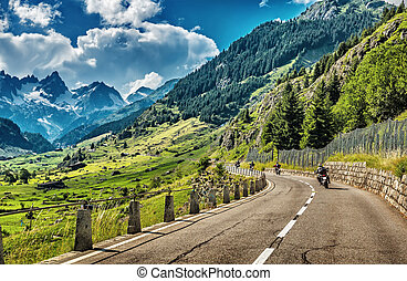 Group of bikers touring European Alps, motorcyclists on...