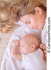 New life concept - Photo of adorable newborn baby with...