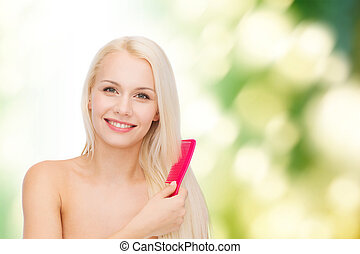 smiling woman with hair brush - health and beauty concept -...