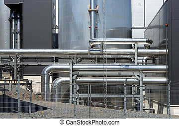 Industrial plant with shiny metal pipes