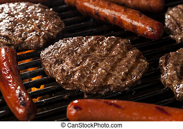 Hamburgers and Hot Dogs on the Grill - Delicious Hamburgers...