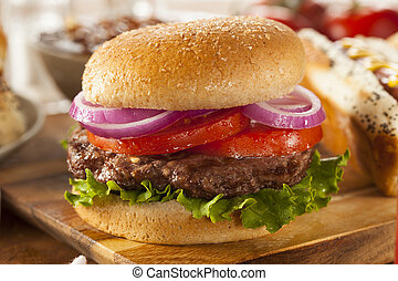 Hearty Grilled Hamburger with Lettuce and Tomato on a Bun